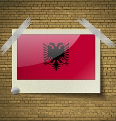 Flags Albania at frame on a brick background vector