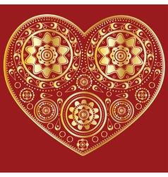 Gold ornamental heart vector