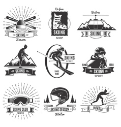 Skiing vintage labels set vector