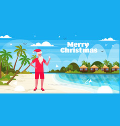 Man wearing santa claus hat using smartphone on vector
