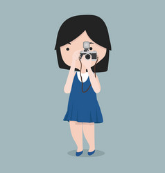 small girl taking photo with camera vector image