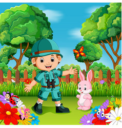 adventure cute boy with rabbit in a flower garden vector image