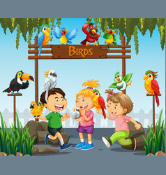 Children playing with parrot birds in zoo vector