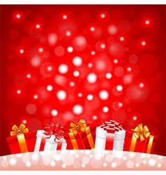 Christmas gifts in the snow on red background vector image