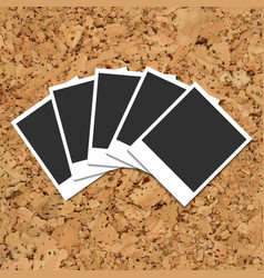 Cork board with scattered photo cards vector