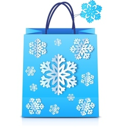 Blue Christmas shopping bag with paper snowflakes vector image vector image