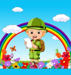 Cartoon boy writing in a flower garden vector