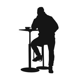 Man silhouette sitting at a table in the cafe bar vector