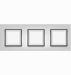 three square black frames hanging on a gray vector image