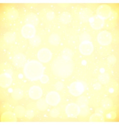 Golden lights blurred background with bokeh effect vector image