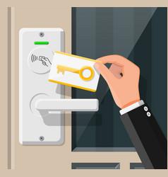 Wireless key card in hand with door handle sensor vector