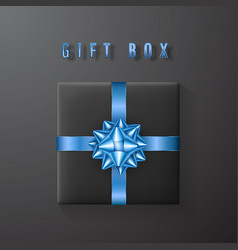 black gift box with blue bow and ribbon top view vector image