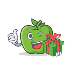 green apple character cartoon with gift vector image