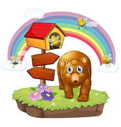 A brown bear near the pethouse and the arrow board vector image