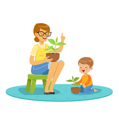 Teacher and little boy learning about plants vector