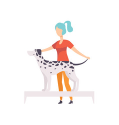 Young woman presenting her purebred dalmatian dog vector