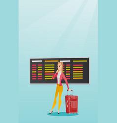 Woman looking at departure board at airport vector