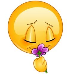 smelling flower emoticon vector image