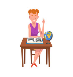 smiling girl sitting at desk and reading book vector image