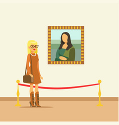 Young woman looking at the painting hanging on vector