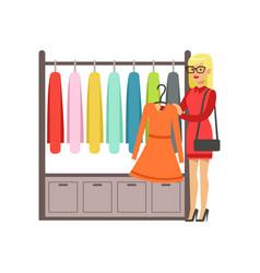 woman choosing dress during shopping beautiful vector image