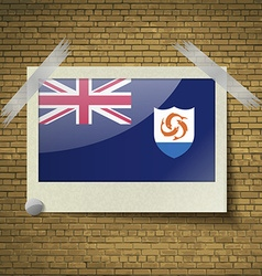 Flags Anguilla at frame on a brick background vector image