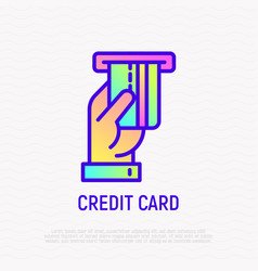hand inserting credit card in atm slot line icon vector image