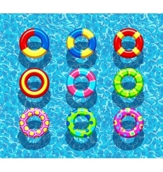 Pool rings on blue water background vector image
