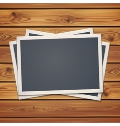 Realistic vintage photo frames on planks vector