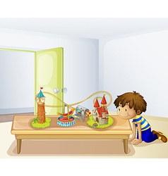 A boy looking at his toys vector