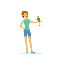 Woman holding tropical bird with colored feathers vector