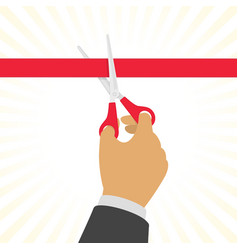 Hand cutting a red ribbon vector