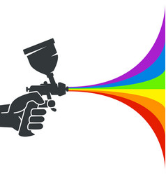 Spray gun with paint in hand vector