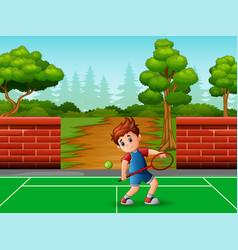 A cute little boy playing tennis vector