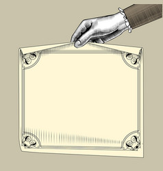 Womans hand holding a paper sheet with retro frame vector