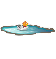 Paper boat with a fallen maple leaf floats vector