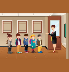 teacher lining up the students vector image
