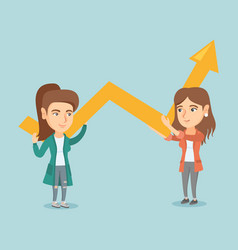Two young business women holding growth graph vector