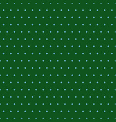 blue polka dots on green background vector image