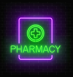 Glowing neon pharmacy signboard on a dark brick vector