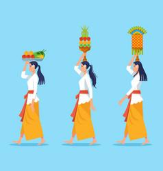 Walking bali women carry offerings for vector