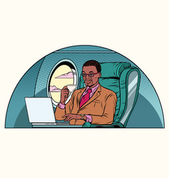 businessman working in the business class cabin vector image