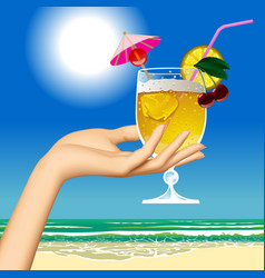 Womans hand holding a fruit cocktail against the vector