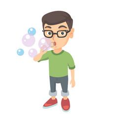 Little caucasian blowing soap bubbles vector