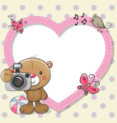 Teddy bear with a camera and a heart frame vector
