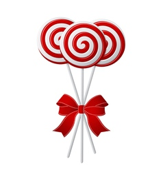 bunch of red and white candies with red ribbon vector image vector image