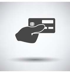 Hand holding credit card icon vector image