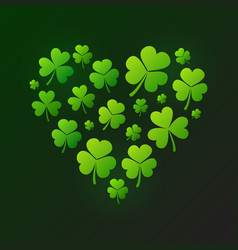 green heart made of small shamrocks on dark vector image