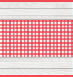 Red tablecloth on white wood table vector