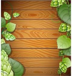 Hops on wooden background vector